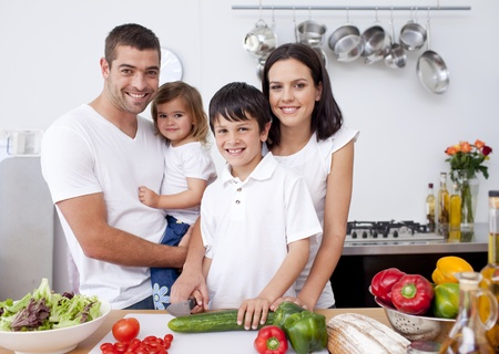 family health: Son preparing food with his family