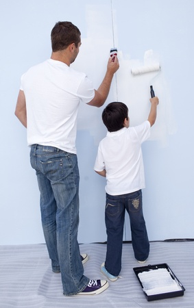 Father and son painting a wall photo