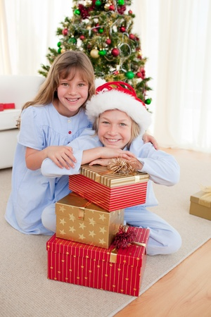 Happy brother and sister holding Christmas presents photo