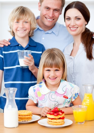 Joyful family eating breakfast in the kitchen Stock Photo - 10076622