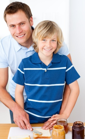 Smiling little boy and his father preparing breakfast Stock Photo - 10076817