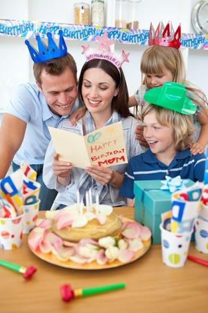 Joyful family celebrating mother's birthday Stock Photo - 10070480