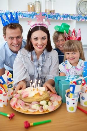 Cheerful family celebrating mothers birthday photo