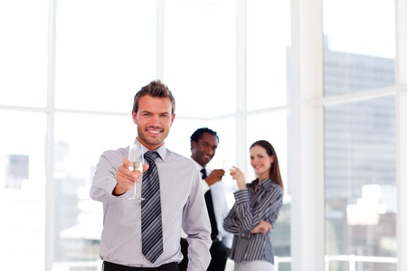 Business people drinking champgne in the office with copy-space Stock Photo - 10112253