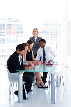 Leadership with her team in a meeting photo