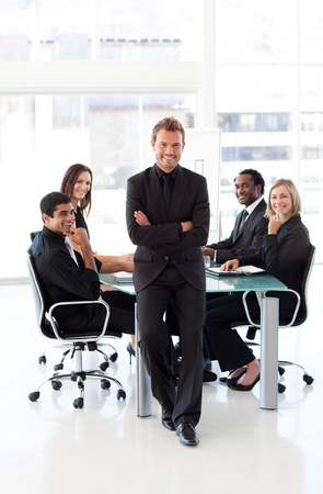 Confident businessman with folded arms in a presentation photo
