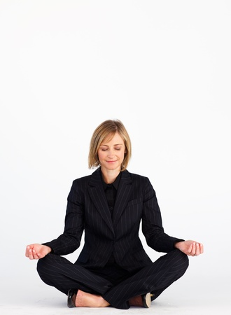 Businesswoman doing yoga with copy-space photo