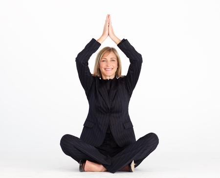 Businesswoman resting on floor doing yoga exercises  photo
