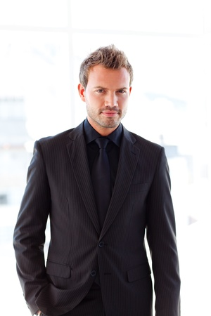 Attractive businessman looking at the camera photo