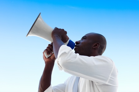 African businessman shouting in a megaphone photo