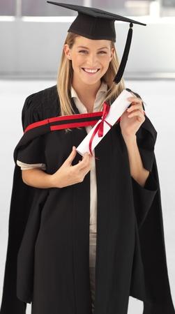 fresh graduate: Woman smiling at her graduation