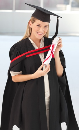 college graduate: Woman smiling at her graduation