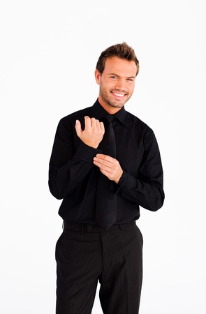Handsome businessman corrects a cuff link Stock Photo - 10113934