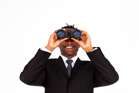 Close-up of a charming Afro-American businessman looking through binoculars photo