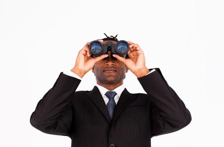 Young businessman looking through binoculars  photo