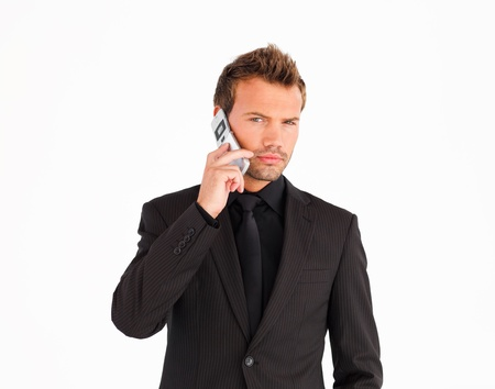 Young businessman using a cell phone Stock Photo - 10110866
