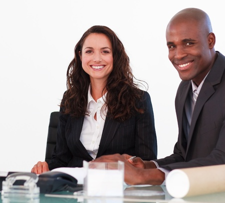 Business team in a meeting looking at the camera Stock Photo - 10109511