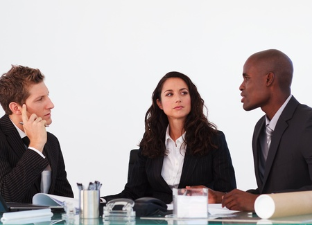 Three business people interacting in a meeting Stock Photo - 10109602