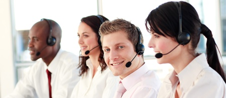 Mixed race business called centre with people on headsets  photo