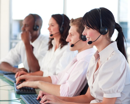 Happy people working in an office Stock Photo - 10110761