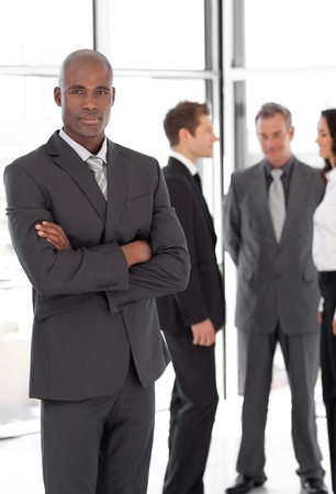 Young Businessman standing out from the Crowd photo