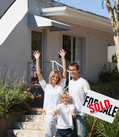 Delighted family buying a house Stock Photo - 10076887