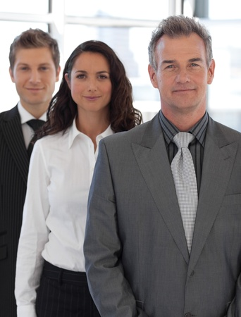 businessteamwork: Senior positive Business team looking at camera