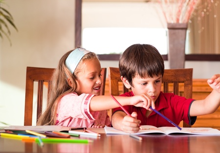 Children doing homework together photo