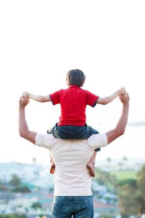 piggyback: Father giving son piggyback ride
