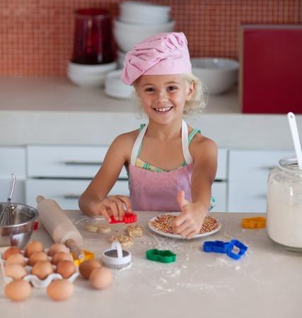 Cute girl baking in a kitchen photo