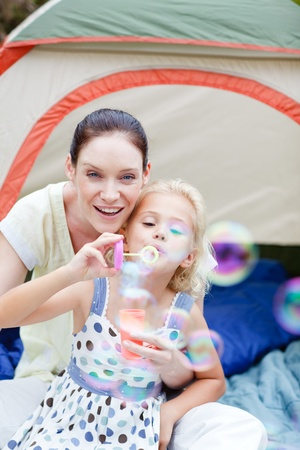 Mother and daughter playing in tent photo