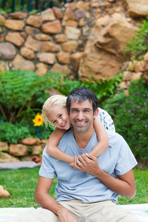 Father giving daughter piggyback Stock Photo - 10070503