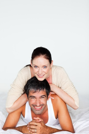 Happy couple in bed with copyspace photo