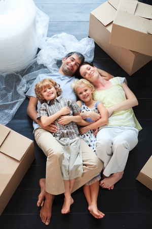 Family sleeping in its new house photo
