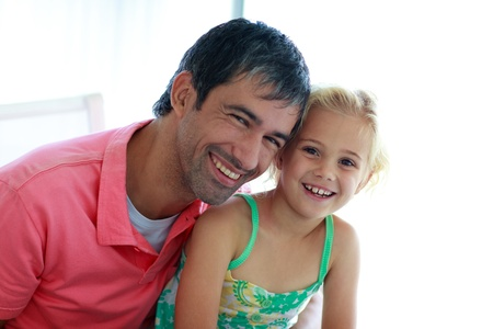 Father and daughter smiling at the camera photo