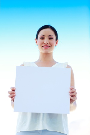 Attractive businesswoman holding a business card photo
