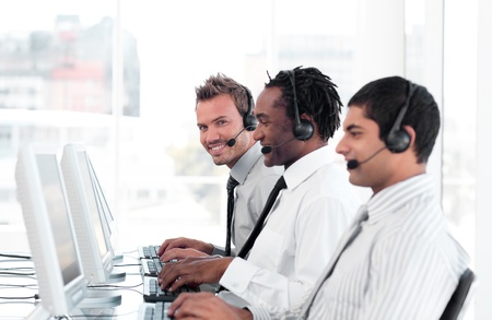 International business team in a call center wearing headsets photo
