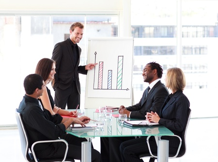Young businessman talking in a presentation Stock Photo - 10110536