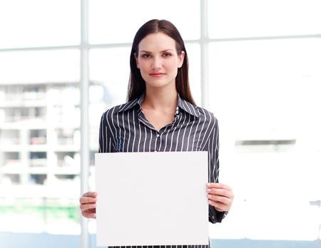busines: Businesswoman holding a busines card