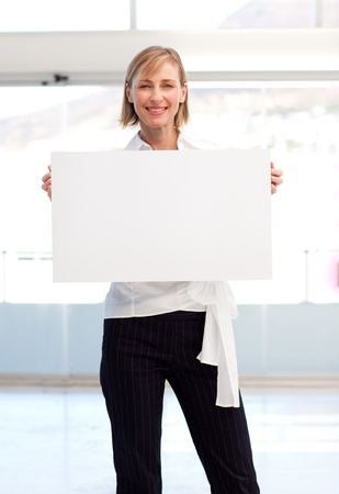 Businesswoman showing her white  card Stock Photo - 10110484