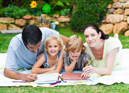 Happy family painting in a garden photo