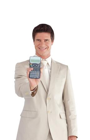 Handsome businessman holding a calculator photo