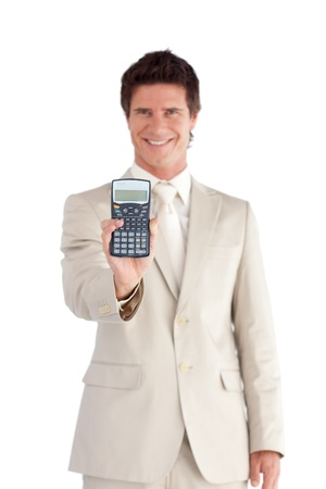 Cheerful businessman holding a calculator photo