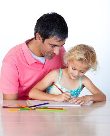 Dad and daughter doing homework together photo