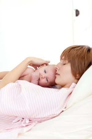 lookalike: Patient relaxing with her newborn baby in bed Stock Photo