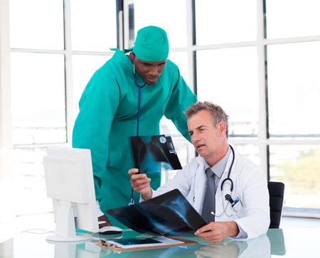 Two doctors talking about two x-rays photo