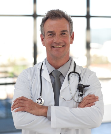 Portrait of a hansdome doctor standing at hospital Stock Photo - 10113678