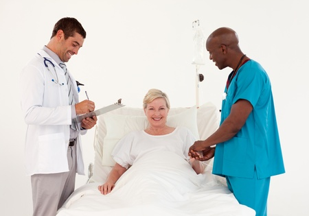 Team of doctor examining a patient  photo