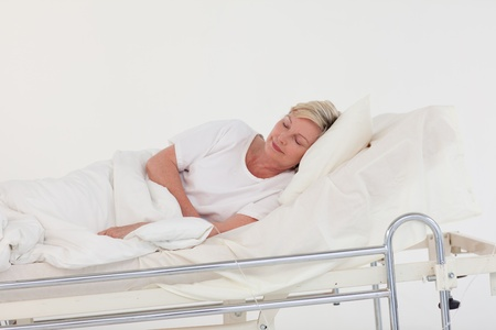 recovering: Relaxed senior woman lying on a bed