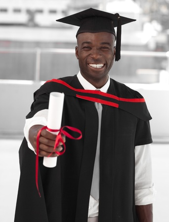 Man smilling at graduation photo
